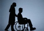 Caregiver pushing family member in wheelchair