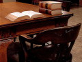 Counsel table in courtroom